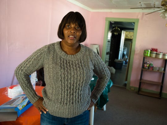 Josie Marie Knott, operator of Pure in Heart Outreach Ministry, stands at the home where she operates the ministry that feeds area families, and who also houses people in need.