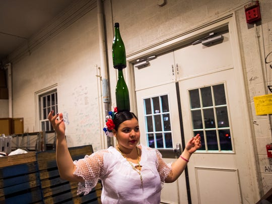 Nadia Romero, a freshman at Gettysburg College and a native of Paraguay, rehearses a traditional Paraguayan bottle dance backstage Saturday Dec. 5, 2015 before the start of performances for the second annual Gettysburg College BurgBurst. The event highlights the multi-culture student body at the school with their talents, fashions and cuisine.