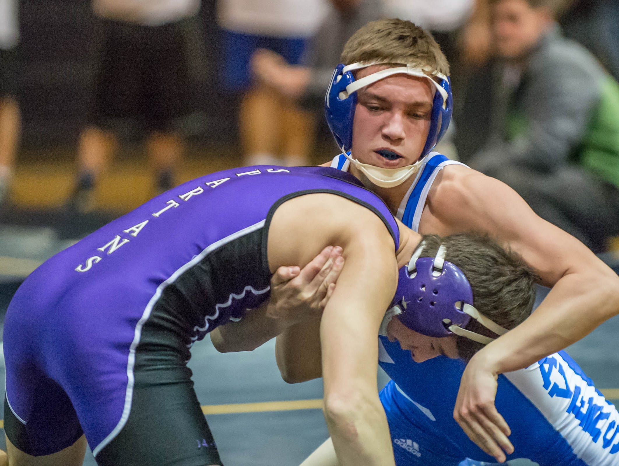 Harper Creek's Hunter Mainstone wrestles Lakeview's Brendan Stevens in the 125 pound weight class in a quad meet held at the Battle Creek Central's Fieldhouse Wednesday evening.