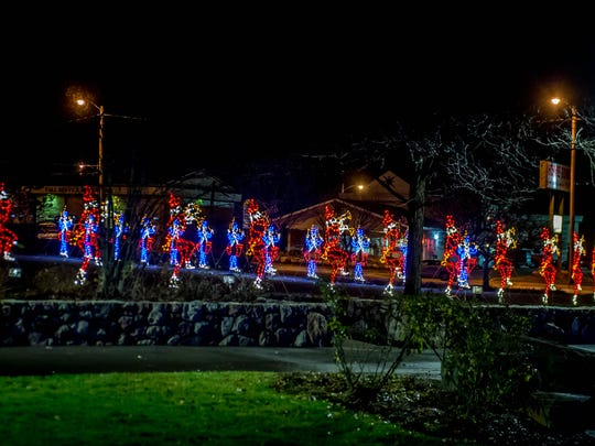 """The """"12 Days of Christmas"""" display is a familiar tradition for International Festival of Lights. The decorations are displayed along the Linear Park trail in downtown Battle Creek."""
