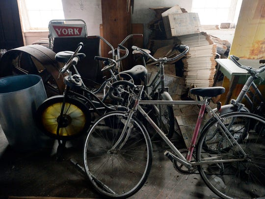 Bicycles, furniture and bins are shown Thursday at