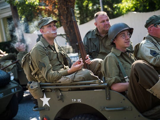 World War II re-enactors make their way back to the Eisenhower Farm after the Liberation of New Oxford World War II re-enactment on Saturday Sept. 19, 2015 in New Oxford.