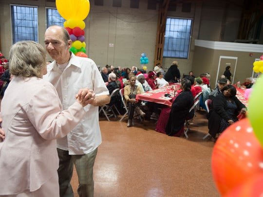 Paul and his wife Jaye Thaggard dance during the Candyland Christmas Ball held by Central Alabama Aging on Wednesday, Dec. 23, 2015.
