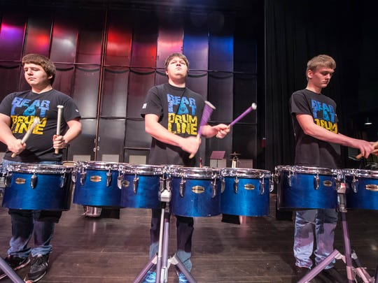 Members of Battle Creek Central's drum line, from left,