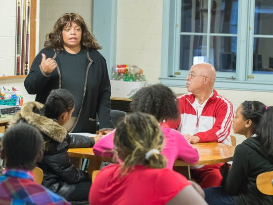 Albion City Manager Sheryl Mitchell, left, and Harry J. Bonner Sr., executive director of Substance Abuse Prevention Services & Kids at Hope Youth Development Center, right, work with Albion middle and high school students during an after-school program.