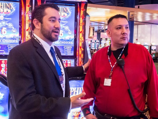 FireKeepers Casino Hotel President and CEO Brian Decorah chats with Harold Morseau, a FireKeepers slot machine attendant,  Jan. 8 at the casino in Emmett Township. Decorah was named the new president of FireKeepers this month, replacing R. Bruce McKee.