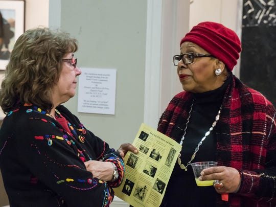 "Executive Director at the Art Center of Battle Creek Linda Holderbaum speaks to ""Art of Soul"" organizer Dorothy Height during opening reception on Sunday."