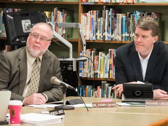 Marshall Public Schools Superintendent Randy Davis and Marshall Board of Education President Richard Lindsey listen at Monday's board meeting, where annexing Albion Public Schools was unanimously approved.