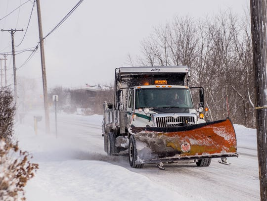 Snow plow truck out along Riverside as as a result of snowfall in January 2016.