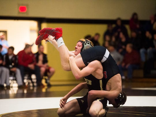 Biglerville's Mitchell Thomas turns Susquehannock's Xander Holloway upside down during the 126-pound bout  at Biglerville High School. Biglerville defeated Susquehannock, 56-12.