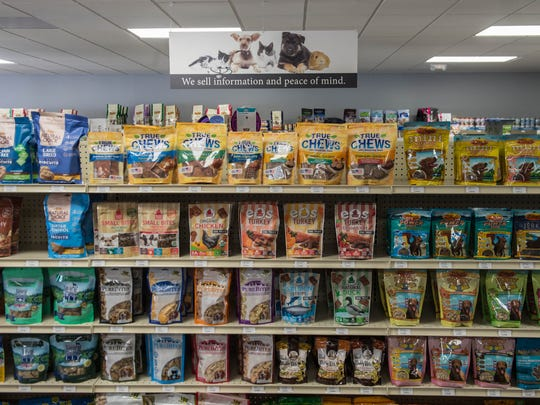 A selection of dog treats at The Scoop, a pet health and wellness center opened last month in Battle Creek.