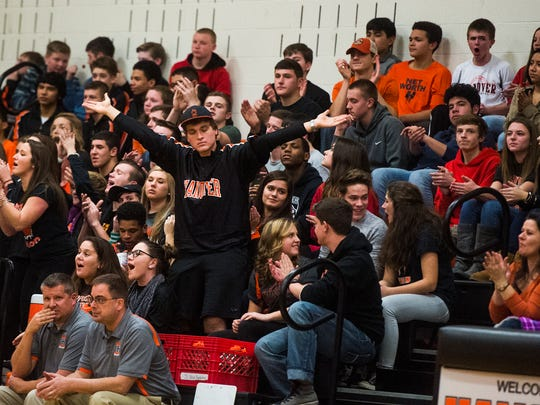 The Hanover student section reacts as Hanover scores