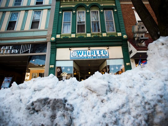 Whirled Records, a business on Carlisle Street in Hanover, had many nearby parking spots covered in snow piles, making access for customers a challenge after the big snow. Now snow will be melting, and a flood watch is in effect.