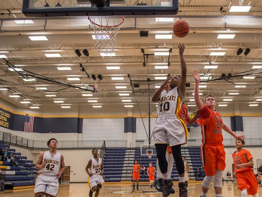 Battle Creek Central's Joshua Mann goes to the hoop