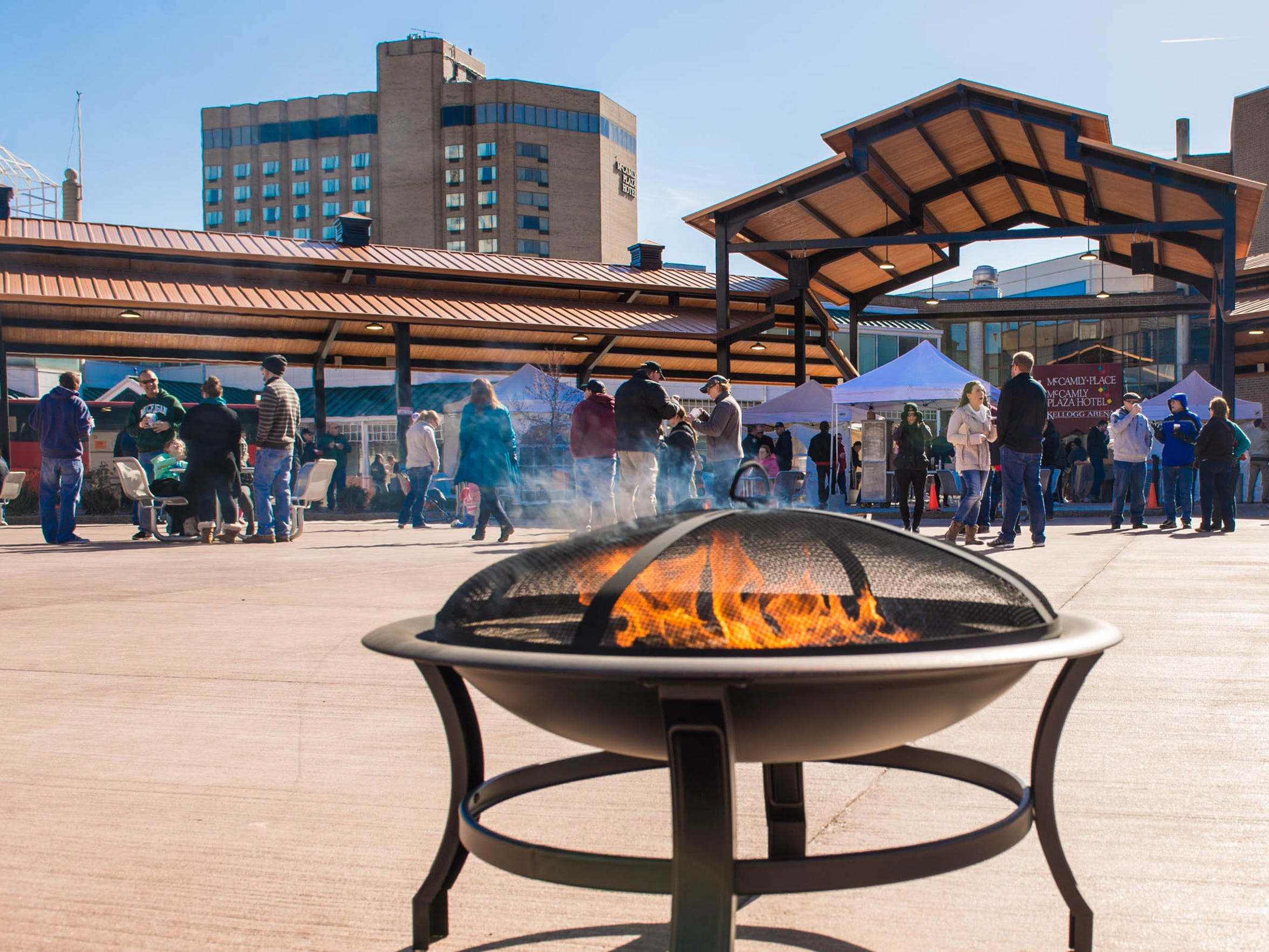Wood burning fire pit at the Pub & Grub Fest, held by the Battle Creek Area Chamber of Commerce, at Festival Market Square on Saturday.