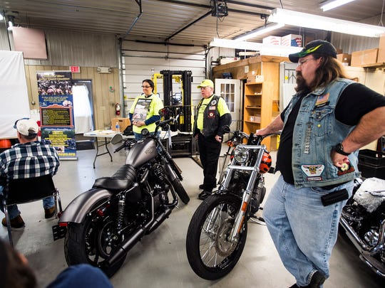Adam Gill, of Carlisle, right, a member of the Blue Mountain chapter of the Alliance of Bikers Aimed Toward Education, listens to a safety course Saturday Feb. 27, 2016 at Battlefield Harley-Davidson. The course was part of the Operation Save-a-Life program offered through the Pennsylvania Alliance of Bikers Aimed Toward Education.