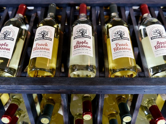 Racks of apple and peach wines are on display at Maple Lawn Winery in Fawn Township.