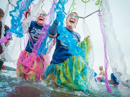 Alli Stover and Sara Cain wade into the Susquehanna River with their umbrella jellyfish costumes during the seventh annual Special Olympics York County Polar Plunge at Donsco near the John Wright Restaurant in Wrightsville on Saturday, March 5, 2016.