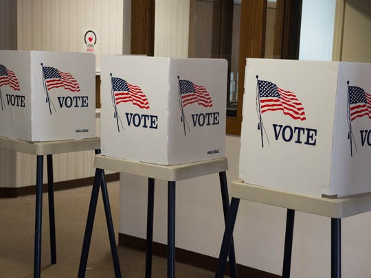 Voting booths are lined up at Christ Community Church, 3142 Capital Ave. S.W. in Battle Creek, for the presidential primary election Tuesday.