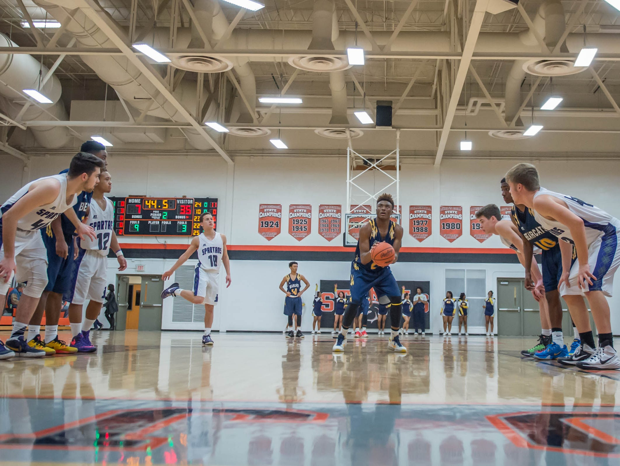Battle Creek Central's Juan Williams (22) goes for the free throw against Lakeview Wednesday night.