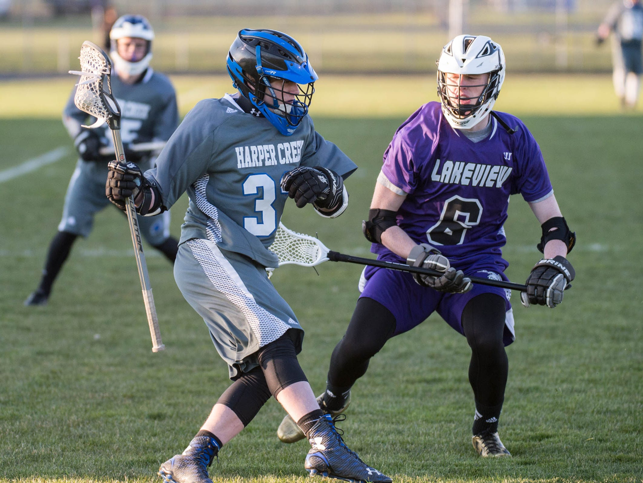 Harper Creek's Noah Bausenrman (32) and Lakeview's Cam Gillette (6) during action on Tuesday.