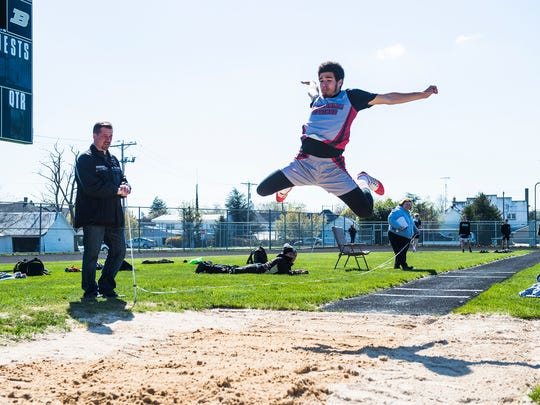 Bermudian Springs' Devon Hodgen competes in the boys' long jump in April at Biglerville High School.