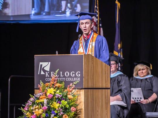 Dakota Glassburn delivers the commencement address during the 2016 Kellogg Community College graduation ceremony.