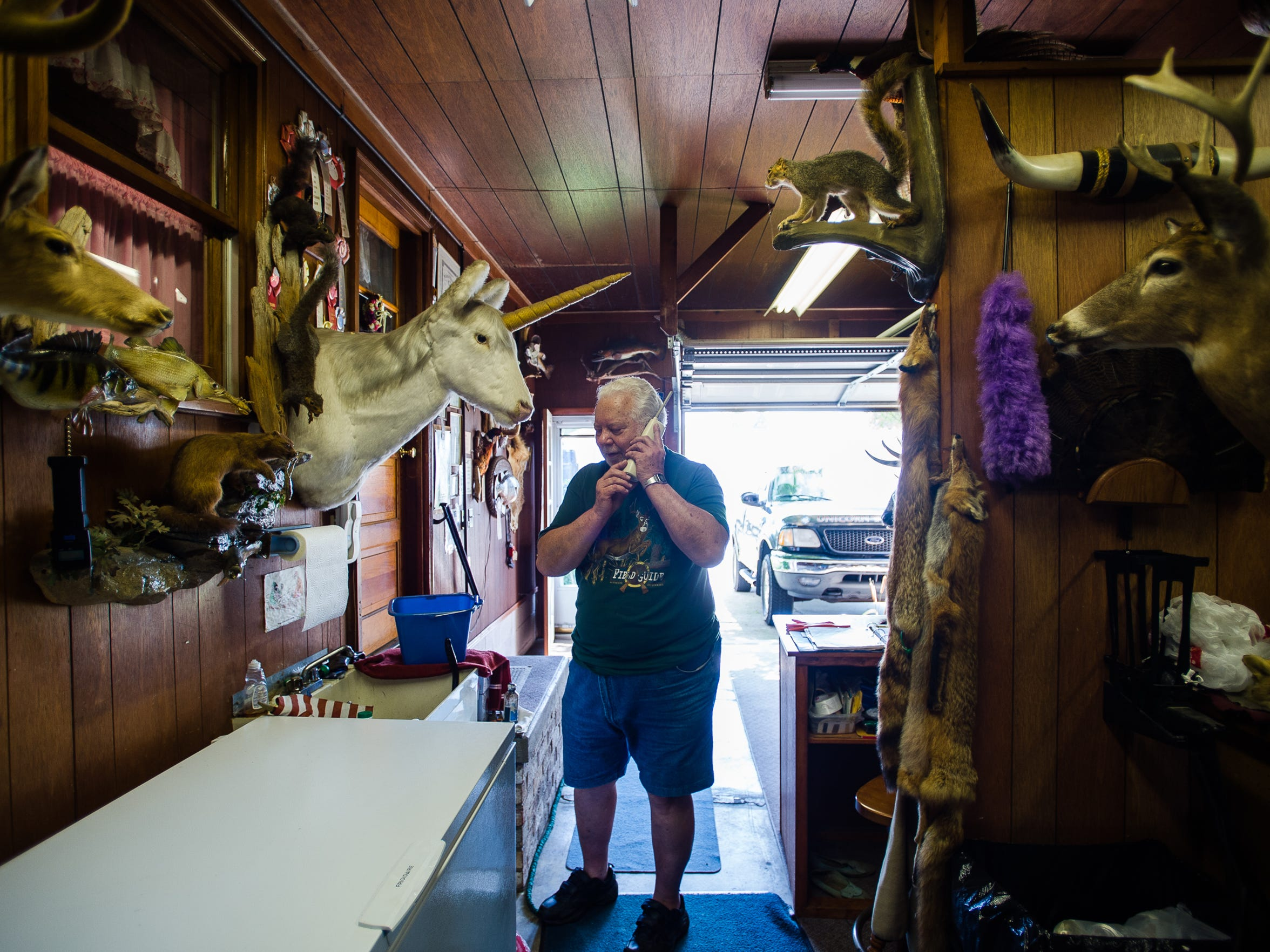 "John Gladfelter takes a phone call at his taxidermy business and home on High Street on Tuesday morning. Gladfelter remembers being home the day of the Miller Chemical fire on June 8, 2015. ""They seem to have taken more precautions,"" Gladfelter said. ""I think they handled it well and got on it right away."""