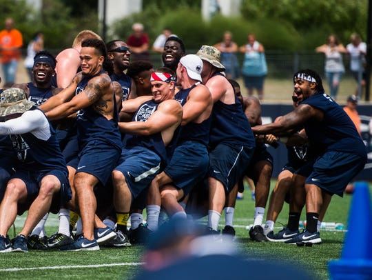 Penn State football players compete in a tug-of-war