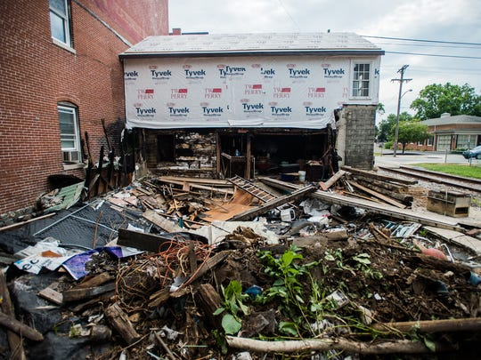The rear of the building on Carlisle Street while crews were cleaning up most of the debris with a dumpster Friday July 22, 2016 in Hanover Borough.