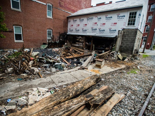 Some debris has been removed from the site of a fire on Carlisle Street that happened last year. On July 19, borough crews began cleaning up most of the garbage that remained at the rear of the property that sits next to Guthrie Memorial Library.