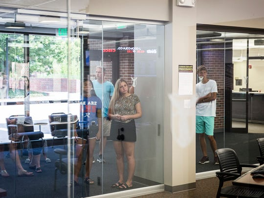 A tour group checks out the Taftali Center in Ball State's Whitinger Business Building Wednesday afternoon.