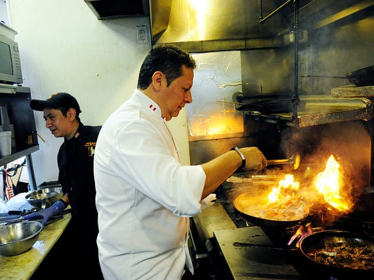 Rafael Rottiers, Inca's Kitchen owner and chef, pan fries some lomo saltado beef in May 2014 at his original location in Golden Gate.