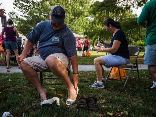 Walkers prepare their heels Friday Aug. 12, 2016 for