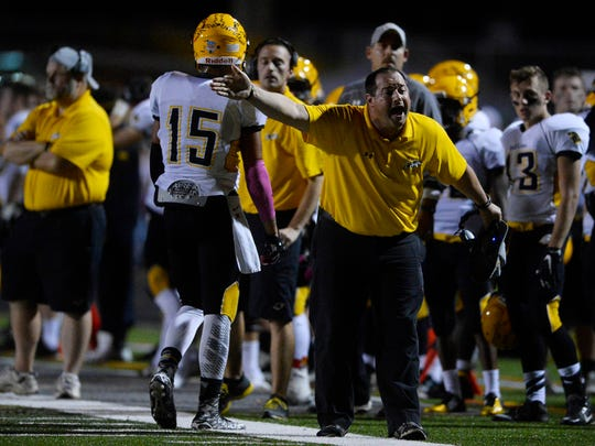 Red Lion coach Jesse Shay yells at the ref during the football game at Dallastown Area High School Friday, November 6, 2015. Red Lion shut out previously undefeated Dallastown winning 26-0.