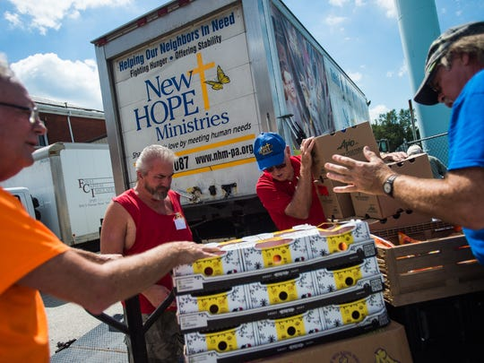 Volunteers work loading produce for the New Hope Ministries mobile food pantry in 2016. Volunteering is one way the Community Progress Council in Hanover encourages people to help those living in poverty.