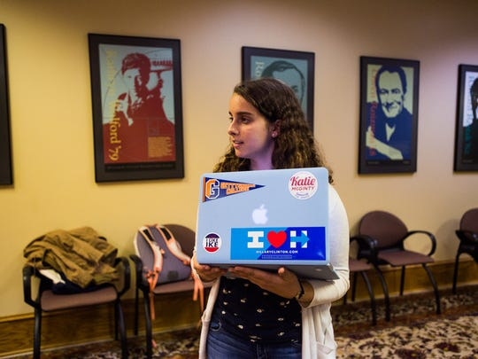 Senior Piper O'Keefe, the chair of the Gettysburg College Democrats, talks with fellow members during a group meeting Nov. 2, 2016 at the Gettysburg College Union to prepare voting information for registered Democrats on campus before Election Day. The student group was working on getting candy, and Democrat voting information, out in the hands of young voters. The polling place for Gettysburg College campus will be at Room 126 in the College Union building.