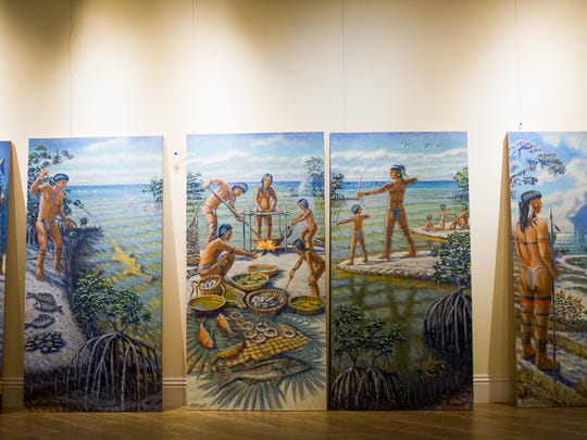 "Art from Paul Arsenault lines the walls of the Marco Island Historical Museum in Marco Island, Fla., on Wednesday, Nov. 2, 2016. The Marco Island Historical Society will present a dramatic permanent outdoor gallery called ""Windows & Doors to History"" at the Marco Island Historical Museum starting with a preview on Nov. 10, 2016."