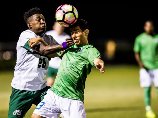 Florida Gulf Coast University's Miguel Jaime goes up for the ball against Jacksonville's Redondo Beauplan during the Atlantic Sun championship in Fort Myers, Fla., on Saturday, Nov. 12, 2016.