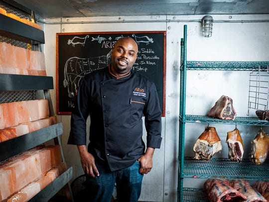 Chef Gerald Sombright stands in the kitchen of Ario