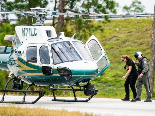 A Lee County Sheriff's Office helicopter arrives near an Interstate 75 off ramp at Corkscrew Road in Estero on Monday, Nov. 14, 2016, after an officer-involved shooting.