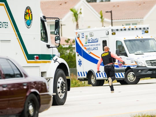 The Lee County Sheriff's Office command center vehicle is escorted near an Interstate 75 off ramp at Corkscrew Road in Estero, Fla., on Monday, Nov. 14, 2016, after an officer-involved shooting.
