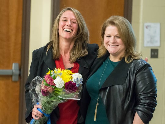 Terri Tchorzynski, left,  with Jill Cook, Assistant Director of the American School Counselor Association during a surprise presentation for receiving the Nation's Counselor of the Year on Thursday.  Tchorzynski is a counselor at the Calhoun Area Career Center in Battle Creek.