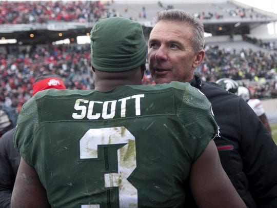 Ohio State coach Urban Meyer congratulated LJ Scott after last season's game, during which Scott rushed 19 times for 160 yards and caught two passes for 74.