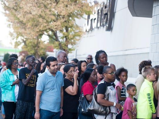 Shoppers wait outside JC Penney in Montgomery, Ala., on Thursday, Nov. 24, 2016.