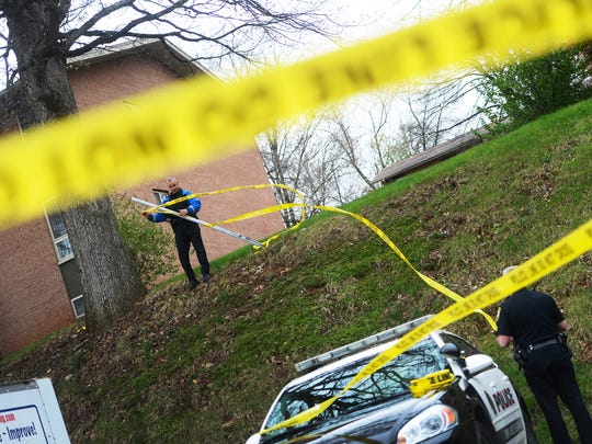 In this file photo from April 29, 2014, police secure the scene of a shooting outside an apartment complex in York Township. John Torres, 35, who previously served as a member of the Baltimore Police Department for 12 years, was  convicted of aggravated assault in September. He was sentenced to serve five to 10 years in prison.