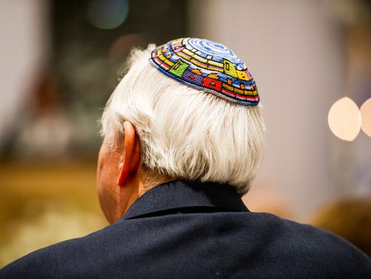 A man wears a Yarmulke during an event in favor of