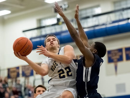 Casey Hoover of Greencastle-Antrim (22) tries to shoot