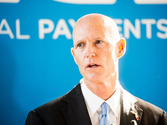 Gov. Rick Scott talks at a press conference about job growth at ACI Worldwide in Naples, Fla., on Monday, Dec. 12, 2016. Scott made a visit to ACI Worldwide, an IT company that powers electronic payments for financial institutions, retailers and processors around the world to talk about Florida's economy.