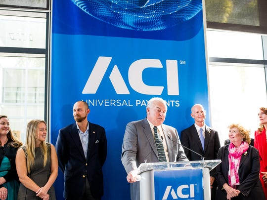 Philip G. Heasley, president and CEO of ACI Worldwide, talks at a news conference about job growth at ACI Worldwide in Naples on Monday, Dec. 12, 2016. Gov. Rick Scott made a visit to ACI Worldwide, an IT company that powers electronic payments for financial institutions, retailers and processers around the world, to talk about Florida's economy.